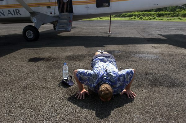 Johnny literally kissing the ground after the almost-crash