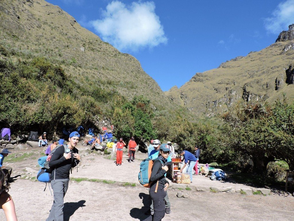 You can see the local Incas selling drinks and snacks to the hikers before the first/highest summit