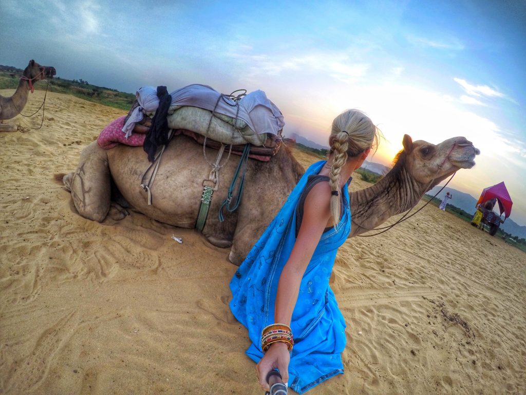 Bonding with a camel after a ride through the sand dunes in Pushkar