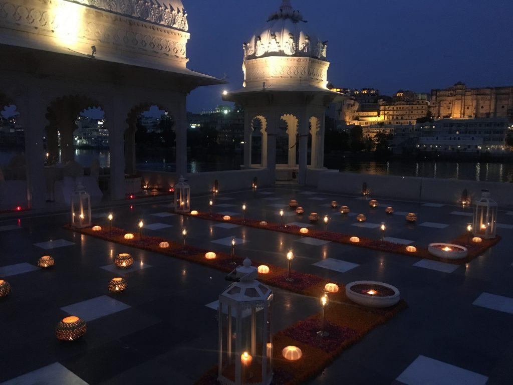 The same deck of the Taj Lake Palace lit up at night for a special evening