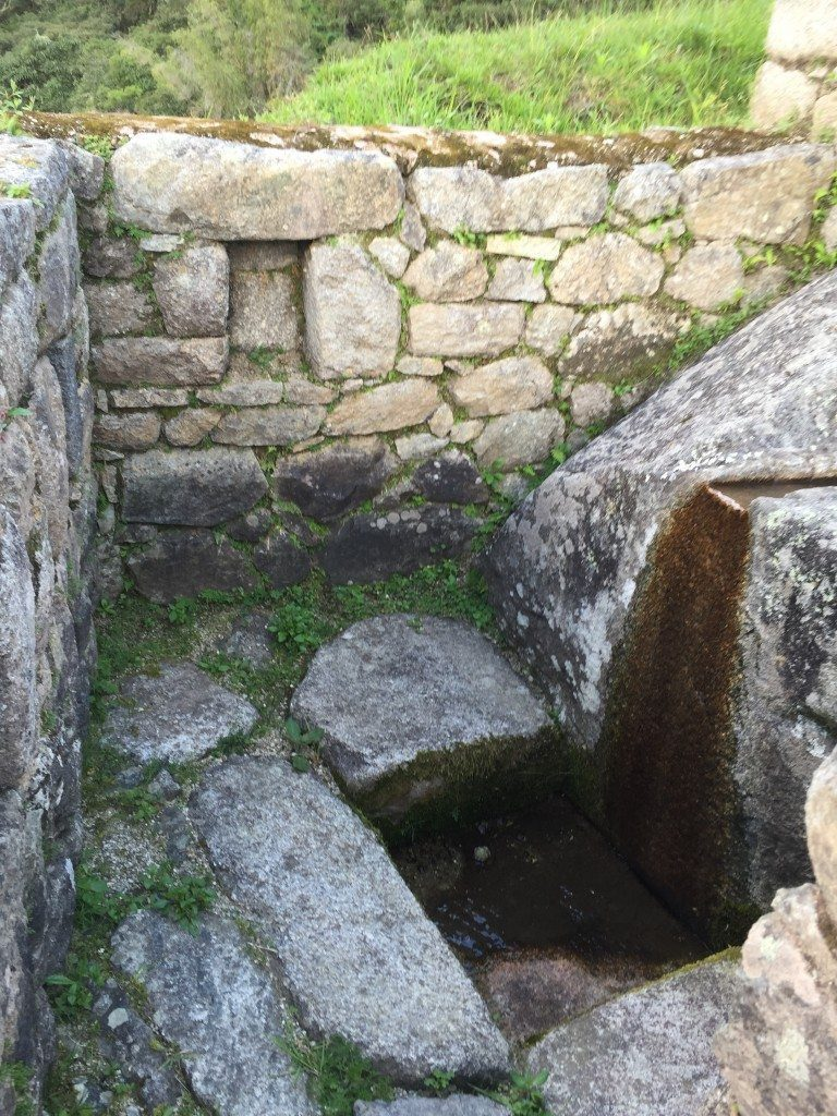 """There were about 15 of these """"stone bath"""" cubicles in a row going down the steps"""