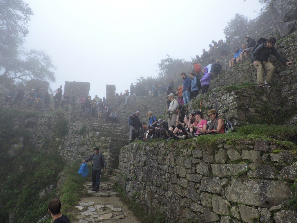 All of the hikers on the last day of the Inca Trail resting and waiting hopefully that the clouds would clear so we could see the aerial view of Machu Picchu