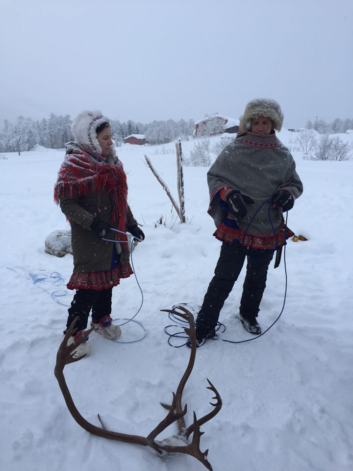 Native Sami couple explaining how they move the Reindeer during winter and summer seasons due to the cold