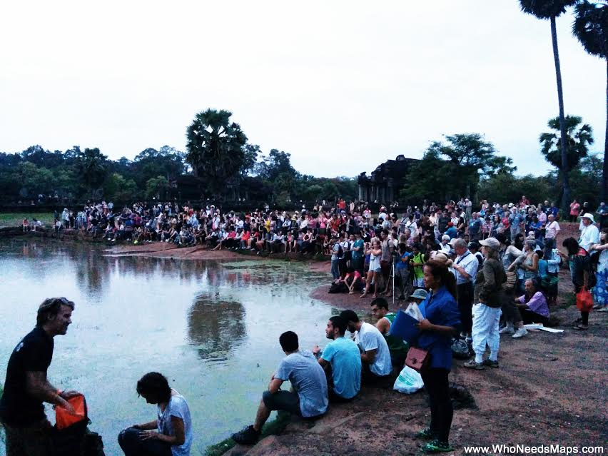 And a photo of the viewing area of Angor Wat shows how many people are there on a regular day.