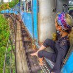solo traveler girl on a train in sri lanka