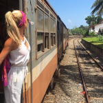 Eco-friendly traveler exploring countryside by train