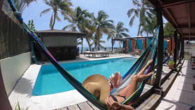 solo traveler relaxing in a hammock