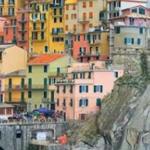 Everything you could possibly need to know to plan a trip to the iconic cities of Cinque Terre! From how to book cheap flights to Italy, to getting around the five cities of Cinque Terre by train, boat, or hiking!
